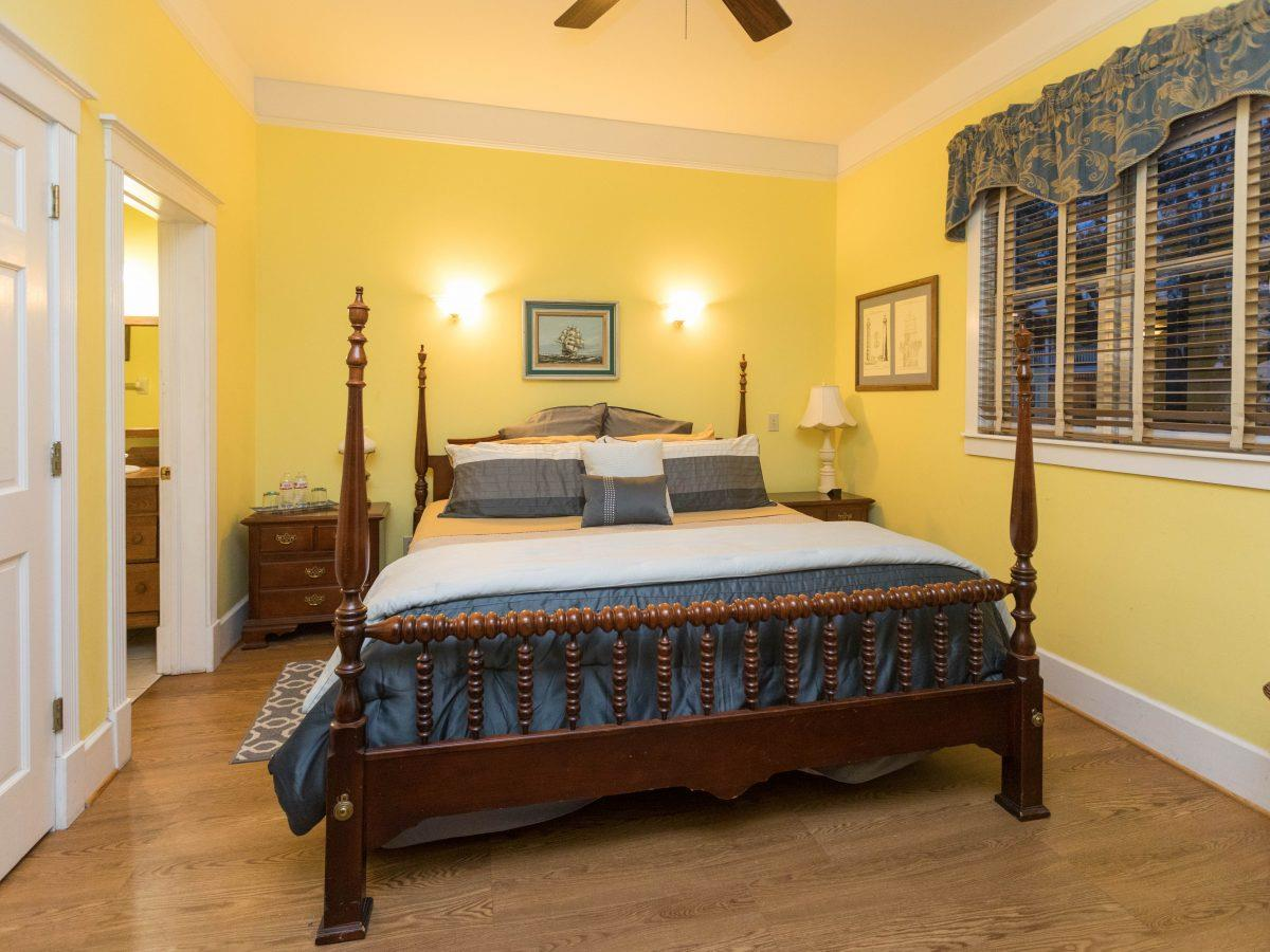 yellow-bedroom-with-four-post-bed.jpg